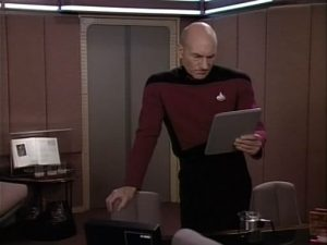 Captain Picard and iPad-like device-a world away